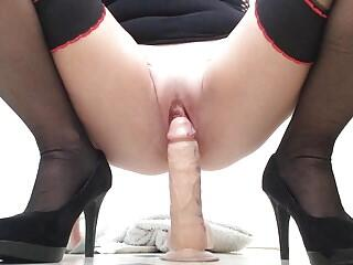Juices dripping down my dildo as I fuck my wet shaved pussy